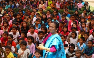 Anuradha Koirala surrounded by supporters at a talk against human trafficking.