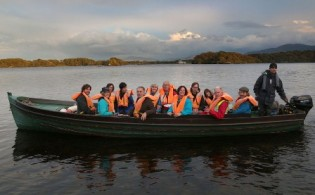 Delegates  and organisers from the Adverture World Travel Summit, enroute to Innisfallen Island, Lough Lein, Killarney National Park, for a special ceremony on the 6th century Monastic Island by Siamsa Tire, The National Folk Theatre of Ireland, included are Chris Doyle, President, Adventure Travel & Trade Asscociation, Moira Murrell, Chief Executive, Kerry County Council, John McCarthy, Tourism Development Officer, Kerry County Council, Cllr John Joe Culluty, Mayor of Killarney, Josephine O'Driscoll, Fáilte Ireland, Michael Gibbons, Archeologist, Jenny De Saulles, Fáilte Ireland, Mike Buckley, Adventure Steering Chairman, and Killarney Boatman, John Michael Lyne.Photo:Valerie O'Sullivan/NO REPRO FEE/ISSUED 07-10-2014