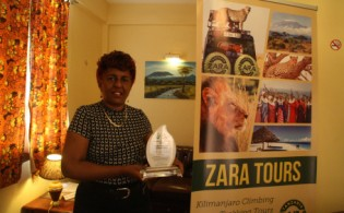 The Director of Zara Tanzania Adventures receive Prize