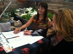 ECPAT USA Michelle Guelbart signing Code with Malia Everette Altruvistas