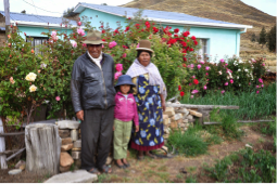One of Santiago de Okola's host family, in front of their house and garden.