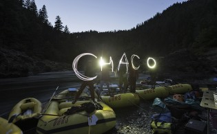 A group of rafters enjoy off river activities while on the Rogue River, OR