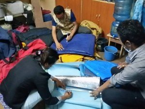 HHT staff including Sushma Tamang pack trekking gear for people in need.