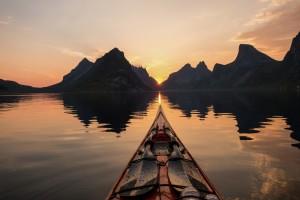 Kayaking Reinefjorden in Lofoten, Norway. Credit: Tomasz Furmanek / Visit Norway