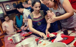 "Members of the ""Sisterhood of Survivors"" in Kathmandu, Nepal, where they welcome travelers on G Adventures tours with a traditional lunch and dumpling making class. © G Adventures, Inc."