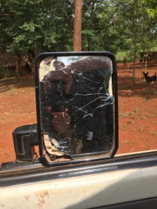 Gunfire shattered the Cruiser's sideview mirror