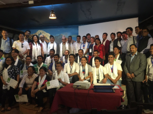 Participants celebrate a successful course