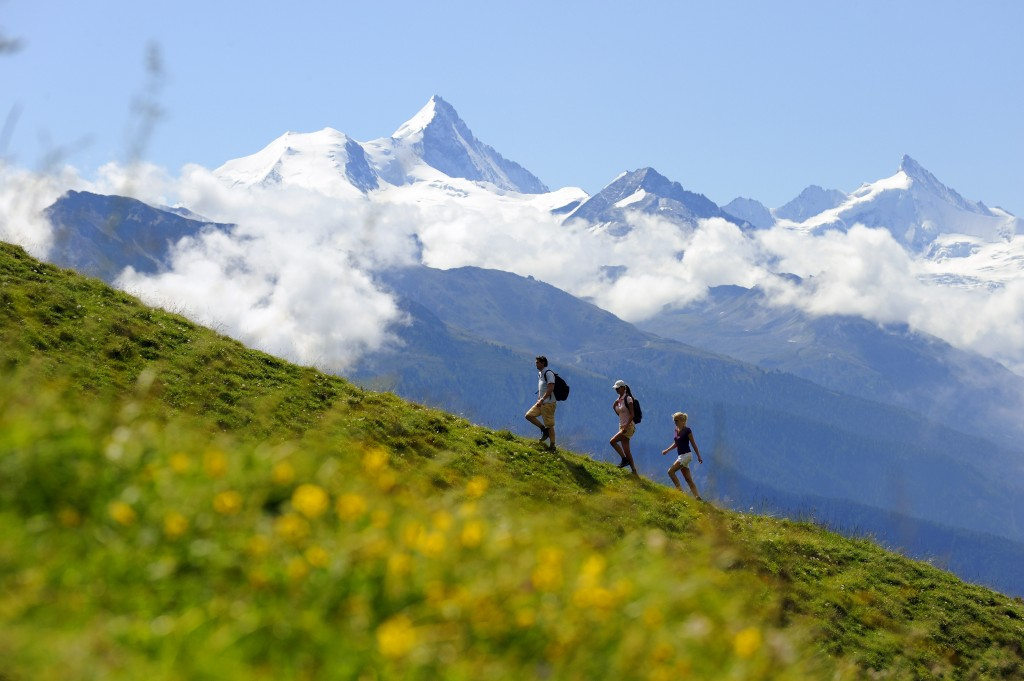 Hiking in the Crans-Montana region in canton Valais with the Valaisan Alps in the background - Credit Switzerland Tourism