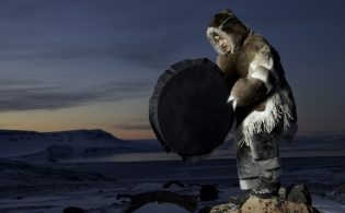 inuit_drum_dancer_wearing_traditional_clothing