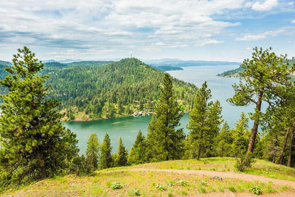 Mineral Ridge rewards Day of Adventure hikers with spanning views of Lake Coeur d'Alene. © ROW Adventures