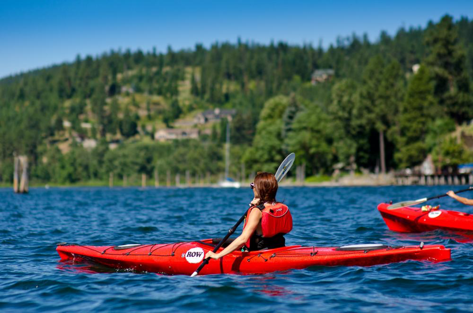 Lake Coeur d'Alene features more than 100 miles of shoreline. Explore crystal clear waters and learn about local Native peoples and history during a kayaking Day of Adventure. © ROW Adventures