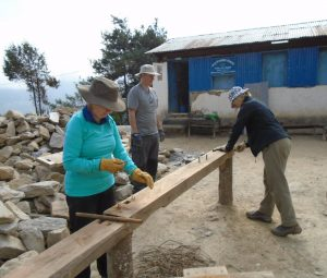Travellers help to rebuild a primary school in Lura village, in the Solu Khumbu region of eastern Nepal in the fall of 2015.