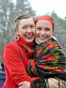 outdoor portrait of two young ukrainian women in traditional ukrainian clothes